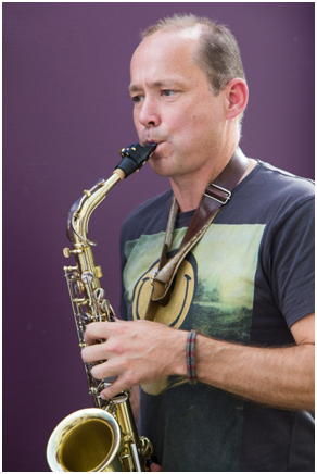 Luke McEwen Playing the saxophone