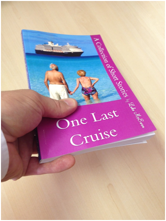 Luke McEwen holding Luke McEwen's book: One Last Cruise